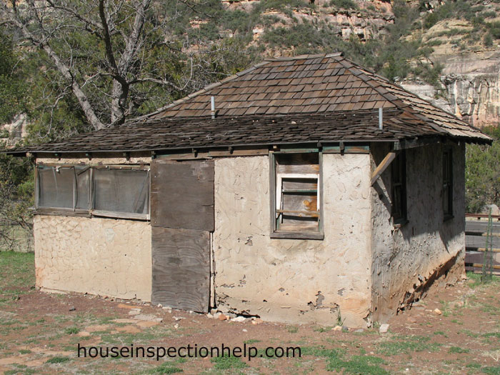 Old Home With Stucco Damage