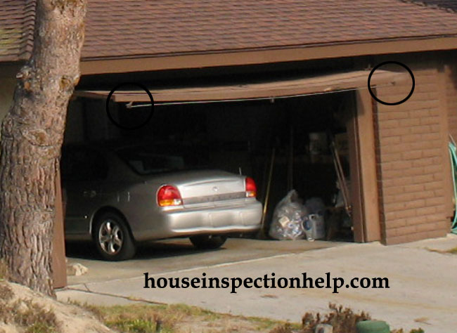 Garage Door Sagging Repair