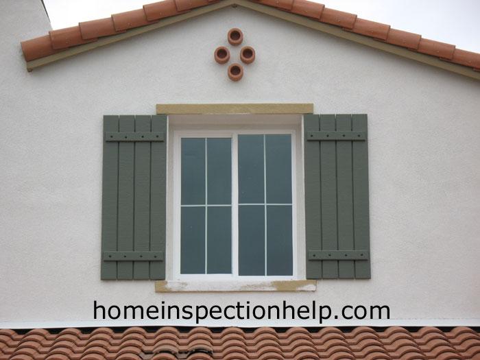 Window Shutters Over Stucco