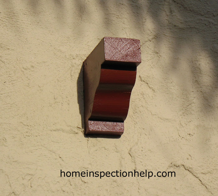 Stucco With Wood Corbel