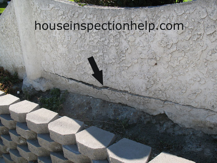 Garden wall stucco damage for Stucco garden wall designs