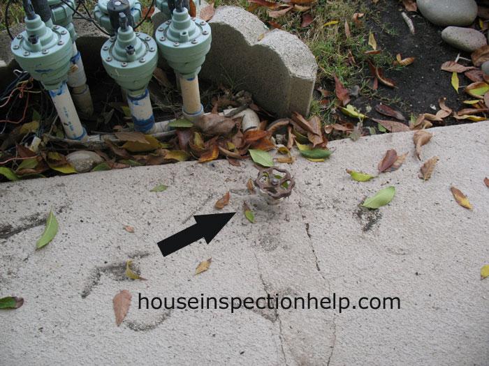 Sprinkler Valve In Concrete Patio
