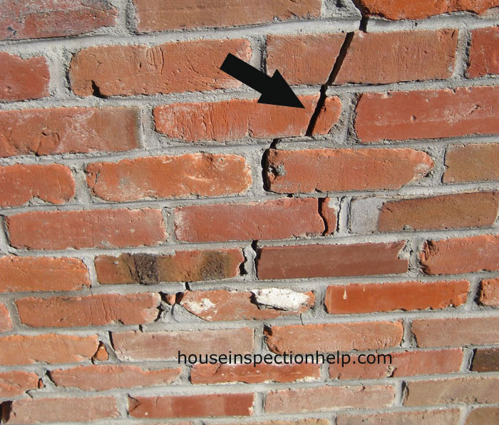 Wide Crack In Brick Wall