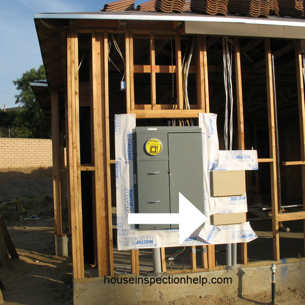 cable tv box next to electric meter on framed house