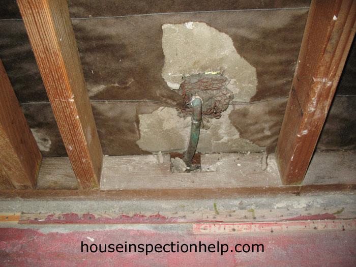 Stucco Damage Behind Plumbing